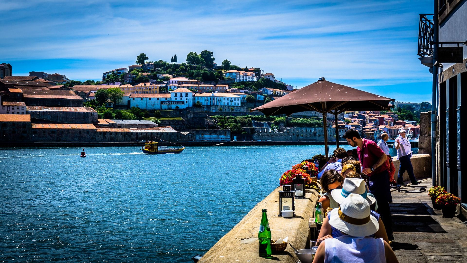 View of the riverside area of the city with a rabelo boat, used for centuries to transport supplies and port wine along the Douro River.